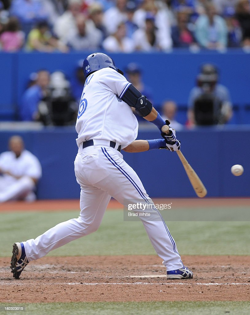 <a gi-track='captionPersonalityLinkClicked' href=/galleries/search?phrase=Munenori+Kawasaki&family=editorial&specificpeople=690355 ng-click='$event.stopPropagation()'>Munenori Kawasaki</a> #66 of the Toronto Blue Jays bats in the eighth inning during MLB game action against the Tampa Bay Rays September 29, 2013 at Rogers Centre in Toronto, Ontario, Canada.