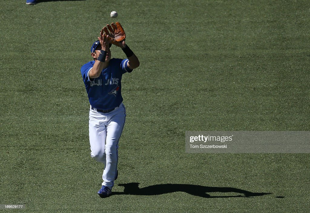 <a gi-track='captionPersonalityLinkClicked' href=/galleries/search?phrase=Munenori+Kawasaki&family=editorial&specificpeople=690355 ng-click='$event.stopPropagation()'>Munenori Kawasaki</a> #66 of the Toronto Blue Jays catches a pop out in the eighth inning during MLB game action against the Baltimore Orioles on May 26, 2013 at Rogers Centre in Toronto, Ontario, Canada.