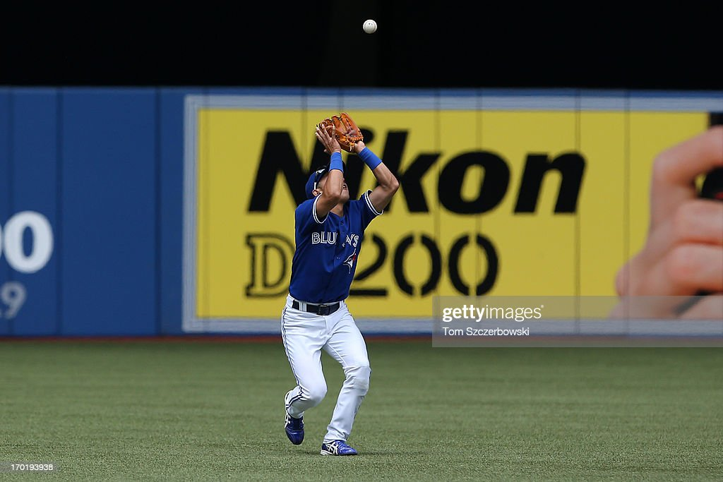 Munenori Kawasaki #66 of the Toronto Blue Jays catches a pop up in the fifth inning during MLB game action against the Texas Rangers on June 8, 2013 at Rogers Centre in Toronto, Ontario, Canada.
