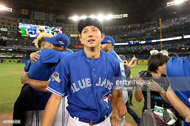 Munenori Kawasaki of the Toronto Blue Jays celebrates after winning Game 5 of the ALDS against the Texas Rangers at the Rogers Centre on Wednesday...