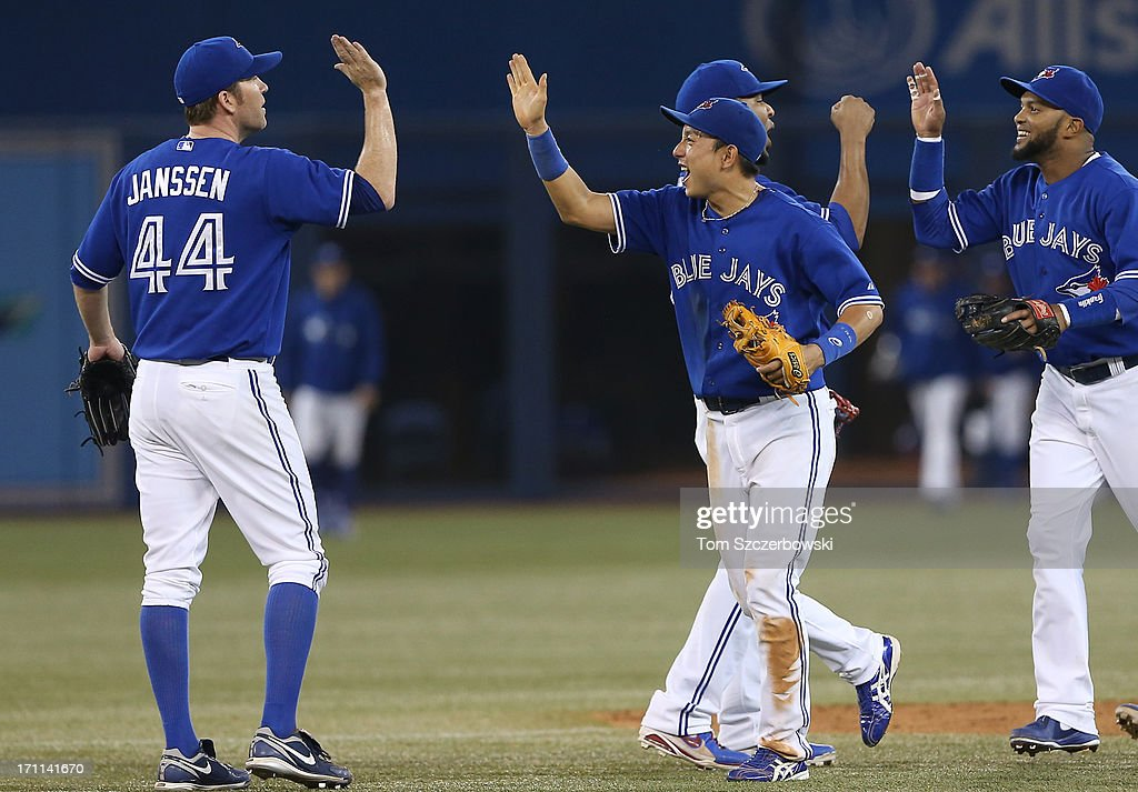 <a gi-track='captionPersonalityLinkClicked' href=/galleries/search?phrase=Munenori+Kawasaki&family=editorial&specificpeople=690355 ng-click='$event.stopPropagation()'>Munenori Kawasaki</a> #66 of the Toronto Blue Jays celebrates the team's tenth consecutive victory with <a gi-track='captionPersonalityLinkClicked' href=/galleries/search?phrase=Casey+Janssen&family=editorial&specificpeople=598479 ng-click='$event.stopPropagation()'>Casey Janssen</a> #44 during MLB game action against the Baltimore Orioles on June 22, 2013 at Rogers Centre in Toronto, Ontario, Canada.