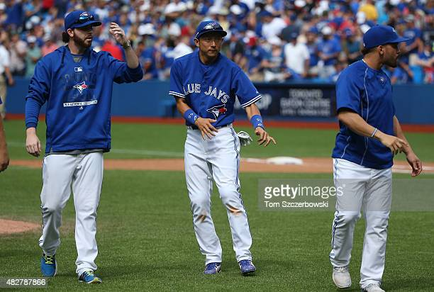 Munenori Kawasaki of the Toronto Blue Jays dances after their victory during MLB game action against the Kansas City Royals on August 2 2015 at...