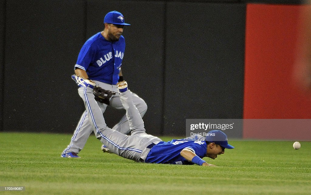 <a gi-track='captionPersonalityLinkClicked' href=/galleries/search?phrase=Munenori+Kawasaki&family=editorial&specificpeople=690355 ng-click='$event.stopPropagation()'>Munenori Kawasaki</a> #66 of the Toronto Blue Jays dives for a single off the bat of Alex Rios #51 of the Chicago White Sox during the fifth inning on June 11, 2013 at U.S. Cellular Field in Chicago, Illinois.