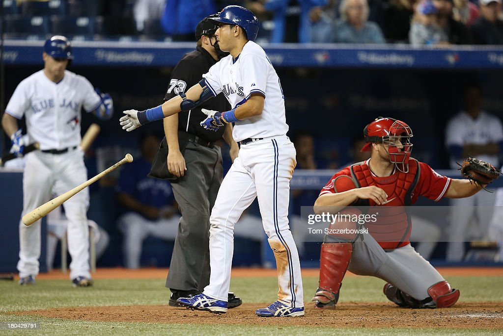 <a gi-track='captionPersonalityLinkClicked' href=/galleries/search?phrase=Munenori+Kawasaki&family=editorial&specificpeople=690355 ng-click='$event.stopPropagation()'>Munenori Kawasaki</a> #66 of the Toronto Blue Jays draws a walk in the ninth inning during MLB game action against the Los Angeles Angels of Anaheim on September 12, 2013 at Rogers Centre in Toronto, Ontario, Canada.