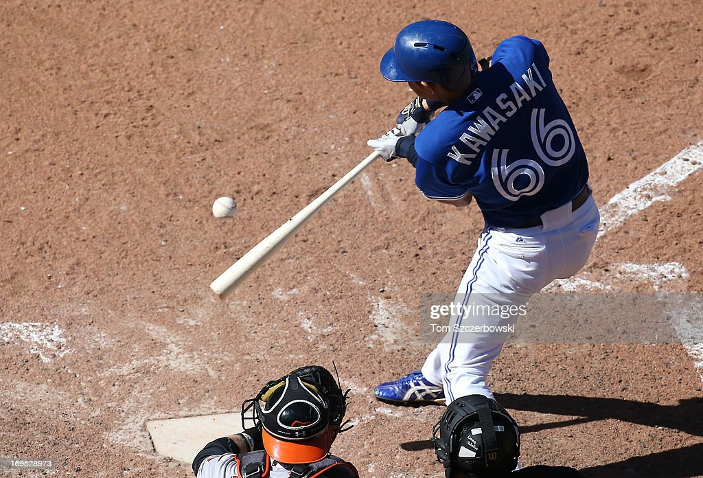 <a gi-track='captionPersonalityLinkClicked' href=/galleries/search?phrase=Munenori+Kawasaki&family=editorial&specificpeople=690355 ng-click='$event.stopPropagation()'>Munenori Kawasaki</a> #66 of the Toronto Blue Jays drives in the game-winning runs in the ninth inning with a double during MLB game action against the Baltimore Orioles on May 26, 2013 at Rogers Centre in Toronto, Ontario, Canada.