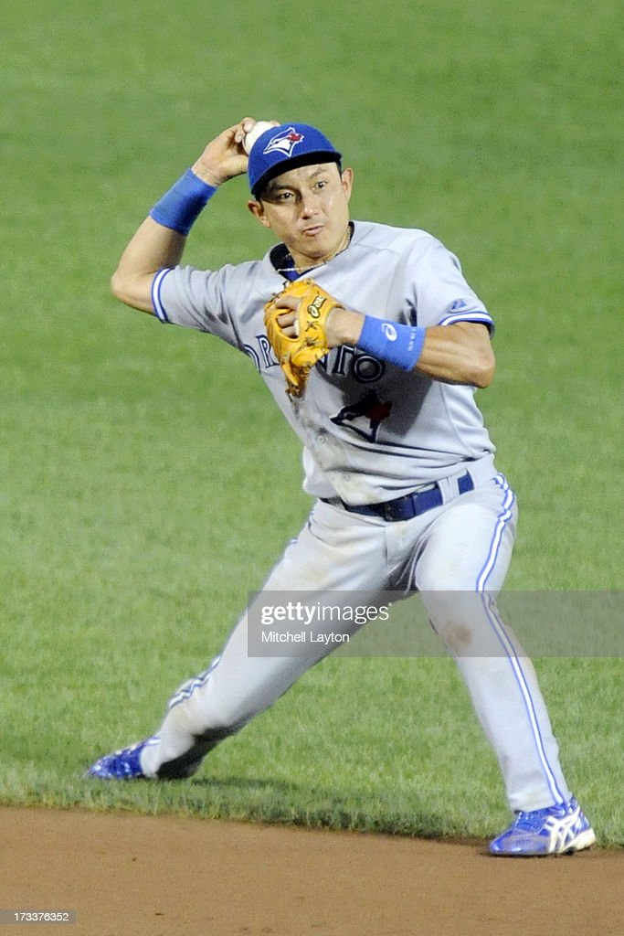 <a gi-track='captionPersonalityLinkClicked' href=/galleries/search?phrase=Munenori+Kawasaki&family=editorial&specificpeople=690355 ng-click='$event.stopPropagation()'>Munenori Kawasaki</a> #66 of the Toronto Blue Jays fields a ground ball during a baseball game against the Baltimore Orioles on July 12, 2013 at Oriole Park at Camden Yards in Baltimore, Maryland.