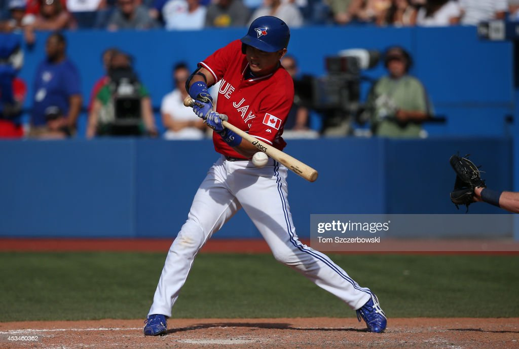<a gi-track='captionPersonalityLinkClicked' href=/galleries/search?phrase=Munenori+Kawasaki&family=editorial&specificpeople=690355 ng-click='$event.stopPropagation()'>Munenori Kawasaki</a> #66 of the Toronto Blue Jays flies out in the eleventh inning during MLB game action against the Detroit Tigers on August 10, 2014 at Rogers Centre in Toronto, Ontario, Canada.
