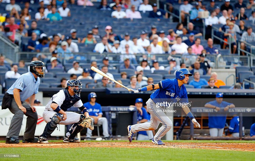 Munenori Kawasaki #66 of the Toronto Blue Jays follows through on a fifth inning base hit against the New York Yankees at Yankee Stadium on August 22, 2013 in the Bronx borough of New York City.