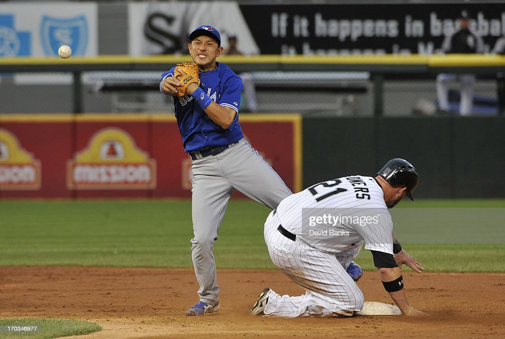<a gi-track='captionPersonalityLinkClicked' href=/galleries/search?phrase=Munenori+Kawasaki&family=editorial&specificpeople=690355 ng-click='$event.stopPropagation()'>Munenori Kawasaki</a> #66 of the Toronto Blue Jays forces out <a gi-track='captionPersonalityLinkClicked' href=/galleries/search?phrase=Tyler+Flowers&family=editorial&specificpeople=4217244 ng-click='$event.stopPropagation()'>Tyler Flowers</a> #21 of the Chicago White Sox during the third inning on June 11, 2013 at U.S. Cellular Field in Chicago, Illinois.
