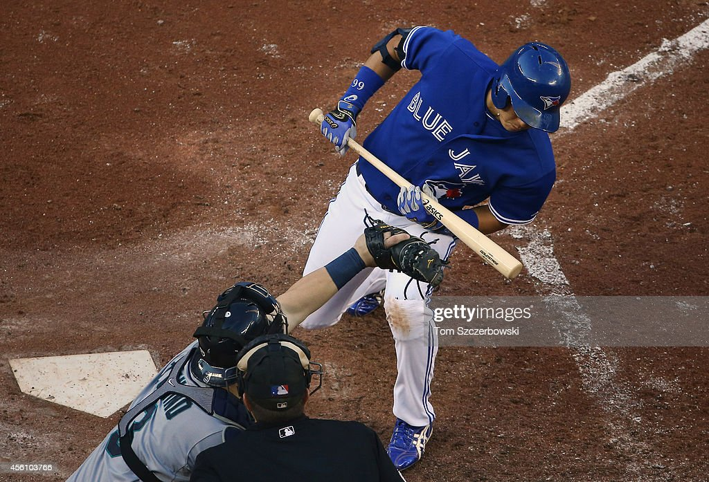 <a gi-track='captionPersonalityLinkClicked' href=/galleries/search?phrase=Munenori+Kawasaki&family=editorial&specificpeople=690355 ng-click='$event.stopPropagation()'>Munenori Kawasaki</a> #66 of the Toronto Blue Jays gets out of the way of a high and inside pitch in the fifth inning during MLB game action as <a gi-track='captionPersonalityLinkClicked' href=/galleries/search?phrase=Mike+Zunino&family=editorial&specificpeople=6803368 ng-click='$event.stopPropagation()'>Mike Zunino</a> #3 of the Seattle Mariners stabs at it on September 25, 2014 at Rogers Centre in Toronto, Ontario, Canada.
