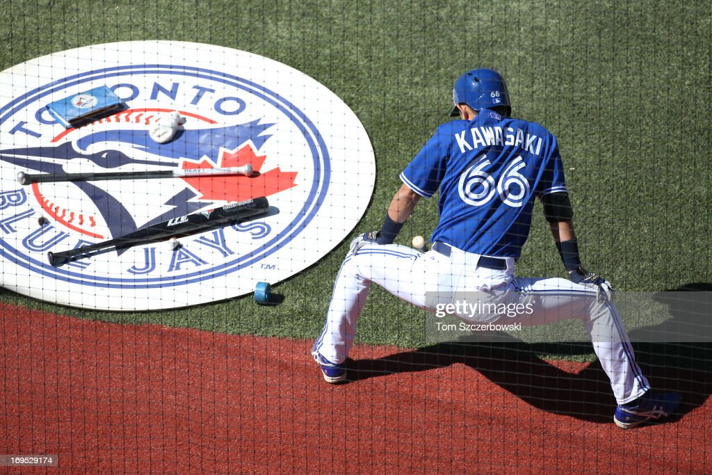 <a gi-track='captionPersonalityLinkClicked' href=/galleries/search?phrase=Munenori+Kawasaki&family=editorial&specificpeople=690355 ng-click='$event.stopPropagation()'>Munenori Kawasaki</a> #66 of the Toronto Blue Jays gets ready to bat from the on-deck circle during MLB game action against the Baltimore Orioles on May 26, 2013 at Rogers Centre in Toronto, Ontario, Canada.