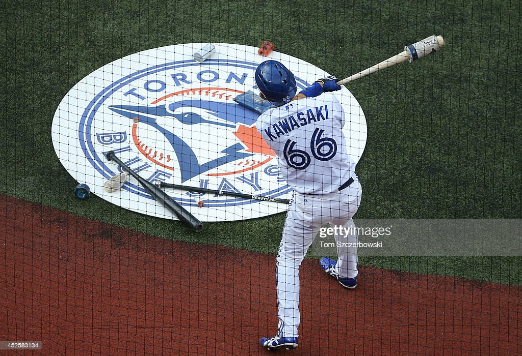 <a gi-track='captionPersonalityLinkClicked' href=/galleries/search?phrase=Munenori+Kawasaki&family=editorial&specificpeople=690355 ng-click='$event.stopPropagation()'>Munenori Kawasaki</a> #66 of the Toronto Blue Jays gets ready to bat from the on-deck circle in the first inning during MLB game action against the Boston Red Sox on July 23, 2014 at Rogers Centre in Toronto, Ontario, Canada.