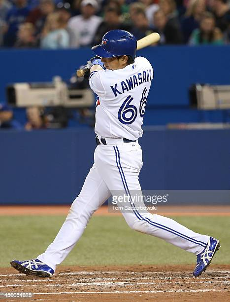 Munenori Kawasaki of the Toronto Blue Jays grounds into a double play in the fifth inning during MLB game action against the Seattle Mariners on...