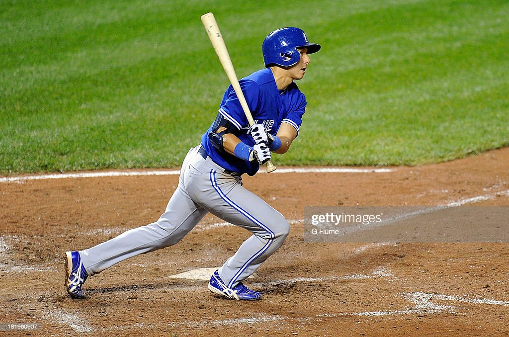 <a gi-track='captionPersonalityLinkClicked' href=/galleries/search?phrase=Munenori+Kawasaki&family=editorial&specificpeople=690355 ng-click='$event.stopPropagation()'>Munenori Kawasaki</a> #66 of the Toronto Blue Jays grounds out to the pitcher in the sixth inning against the Baltimore Orioles at Oriole Park at Camden Yards on September 26, 2013 in Baltimore, Maryland.