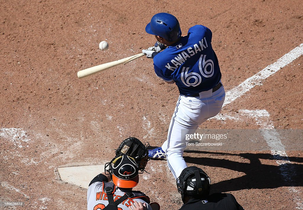 <a gi-track='captionPersonalityLinkClicked' href=/galleries/search?phrase=Munenori+Kawasaki&family=editorial&specificpeople=690355 ng-click='$event.stopPropagation()'>Munenori Kawasaki</a> #66 of the Toronto Blue Jays hits an RBI single and breaks his bat in the eighth inning during MLB game action against the Baltimore Orioles on May 26, 2013 at Rogers Centre in Toronto, Ontario, Canada.