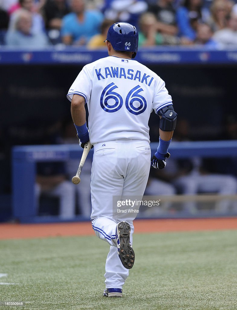 <a gi-track='captionPersonalityLinkClicked' href=/galleries/search?phrase=Munenori+Kawasaki&family=editorial&specificpeople=690355 ng-click='$event.stopPropagation()'>Munenori Kawasaki</a> #66 of the Toronto Blue Jays jogs back to the dugout in the eighth inning during MLB game action against the Tampa Bay Rays September 29, 2013 at Rogers Centre in Toronto, Ontario, Canada.