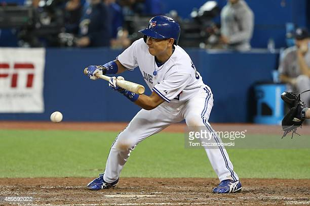 Munenori Kawasaki of the Toronto Blue Jays lays down a sacrifice bunt in the eighth inning during MLB game action against the New York Yankees on...