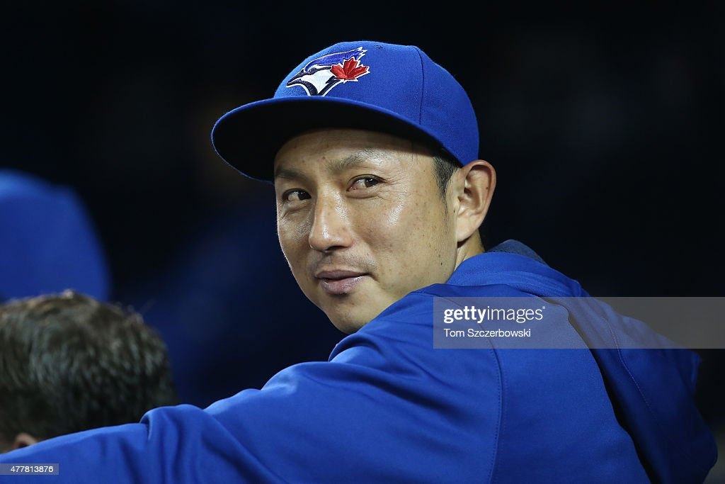 Munenori Kawasaki #66 of the Toronto Blue Jays looks on from the dugout during MLB game action against the Baltimore Orioles on June 19, 2015 at Rogers Centre in Toronto, Ontario, Canada.