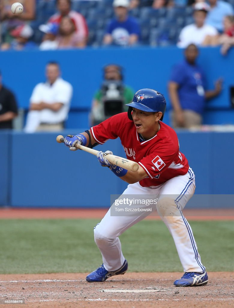 <a gi-track='captionPersonalityLinkClicked' href=/galleries/search?phrase=Munenori+Kawasaki&family=editorial&specificpeople=690355 ng-click='$event.stopPropagation()'>Munenori Kawasaki</a> #66 of the Toronto Blue Jays pops up a sacrifice bunt attempt leading to an out in the fifteenth inning during MLB game action against the Detroit Tigers on August 10, 2014 at Rogers Centre in Toronto, Ontario, Canada.