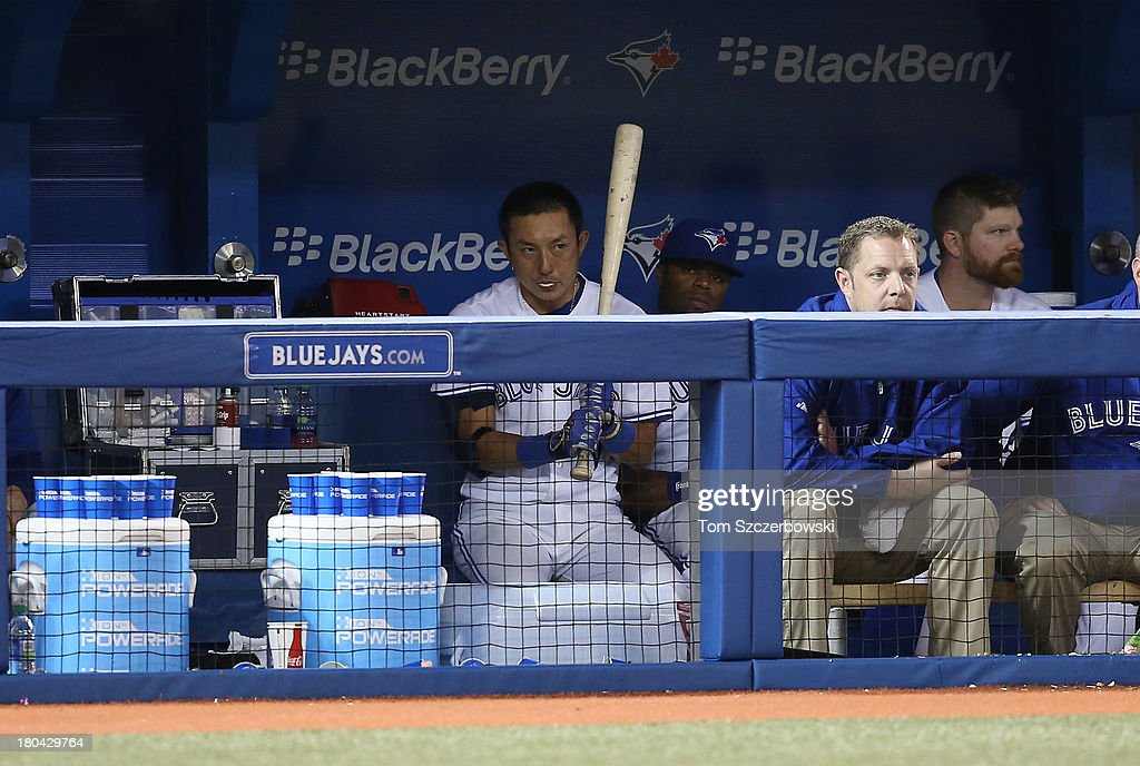 <a gi-track='captionPersonalityLinkClicked' href=/galleries/search?phrase=Munenori+Kawasaki&family=editorial&specificpeople=690355 ng-click='$event.stopPropagation()'>Munenori Kawasaki</a> #66 of the Toronto Blue Jays prepares to bat from the dugout during MLB game action against the Los Angeles Angels of Anaheim on September 12, 2013 at Rogers Centre in Toronto, Ontario, Canada.