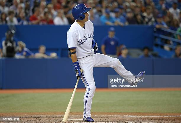 Munenori Kawasaki of the Toronto Blue Jays reacts after a swing in the seventh inning during MLB game action against the Boston Red Sox on July 23...