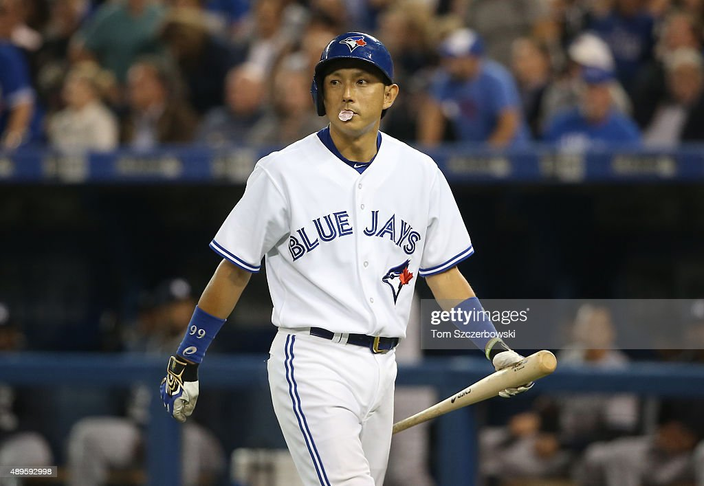 Munenori Kawasaki #66 of the Toronto Blue Jays reacts after being called out on strikes in the fifth inning during MLB game action against the New York Yankees on September 22, 2015 at Rogers Centre in Toronto, Ontario, Canada.
