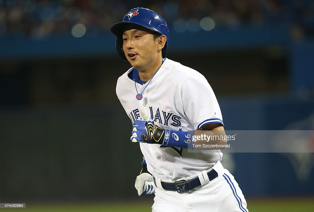 <a gi-track='captionPersonalityLinkClicked' href=/galleries/search?phrase=Munenori+Kawasaki&family=editorial&specificpeople=690355 ng-click='$event.stopPropagation()'>Munenori Kawasaki</a> #66 of the Toronto Blue Jays reacts after grounding out and advancing the runner to second base in the third inning during MLB game action against the Seattle Mariners on May 22, 2015 at Rogers Centre in Toronto, Ontario, Canada.