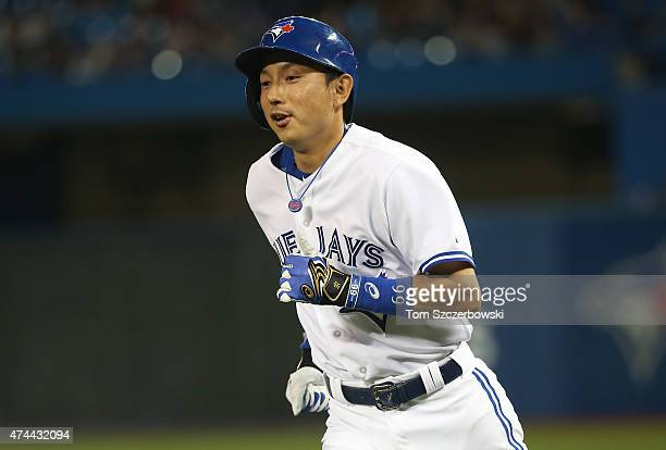 Munenori Kawasaki of the Toronto Blue Jays reacts after grounding out and advancing the runner to second base in the third inning during MLB game...