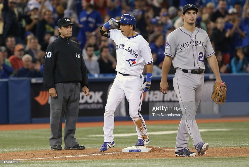 <a gi-track='captionPersonalityLinkClicked' href=/galleries/search?phrase=Munenori+Kawasaki&family=editorial&specificpeople=690355 ng-click='$event.stopPropagation()'>Munenori Kawasaki</a> #66 of the Toronto Blue Jays reacts after hitting a triple in the seventh inning during MLB game action against the Colorado Rockies on June 19, 2013 at Rogers Centre in Toronto, Ontario, Canada.