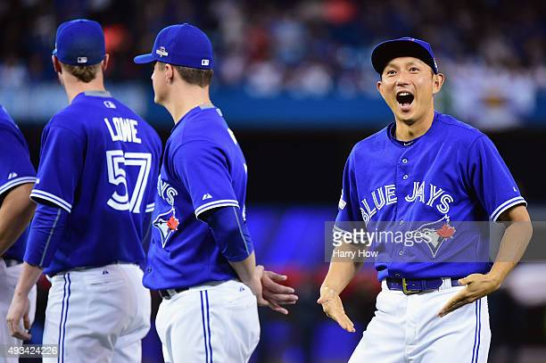 Munenori Kawasaki of the Toronto Blue Jays reacts prior to game three of the American League Championship Series between the Toronto Blue Jays and...