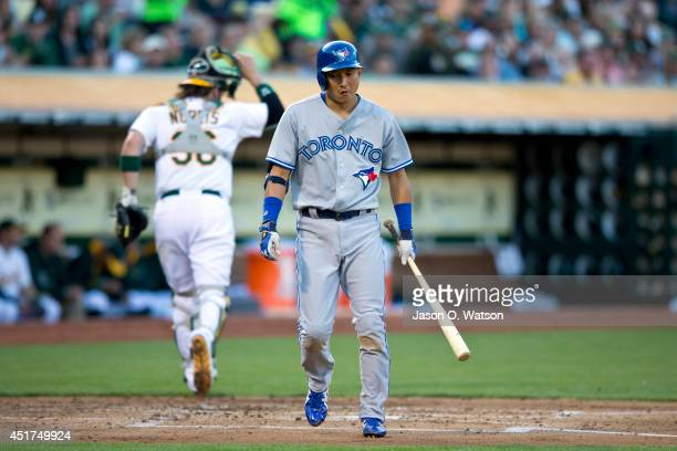 Munenori Kawasaki of the Toronto Blue Jays returns to the dugout after striking out against the Oakland Athletics during the second inning at Oco...