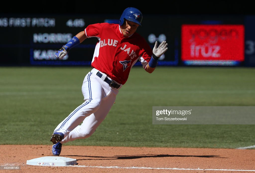 <a gi-track='captionPersonalityLinkClicked' href=/galleries/search?phrase=Munenori+Kawasaki&family=editorial&specificpeople=690355 ng-click='$event.stopPropagation()'>Munenori Kawasaki</a> #66 of the Toronto Blue Jays runs around third base and towards home plate to score a run in the seventh inning during MLB game action against the Detroit Tigers on August 10, 2014 at Rogers Centre in Toronto, Ontario, Canada.