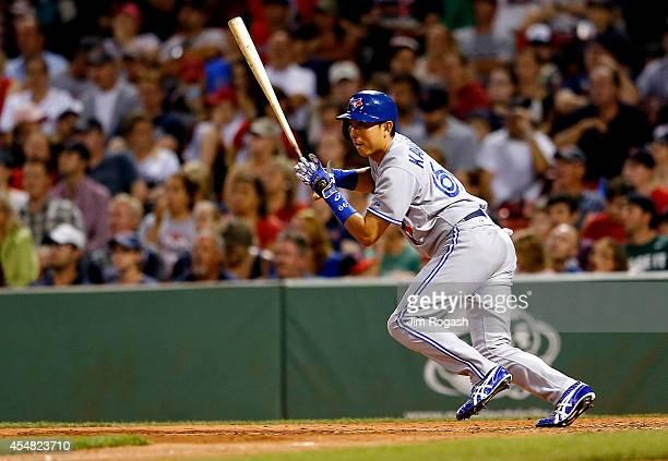 Munenori Kawasaki of the Toronto Blue Jays singles in the seventh inning against the Boston Red Sox at Fenway Park on September 6 2014 in Boston...