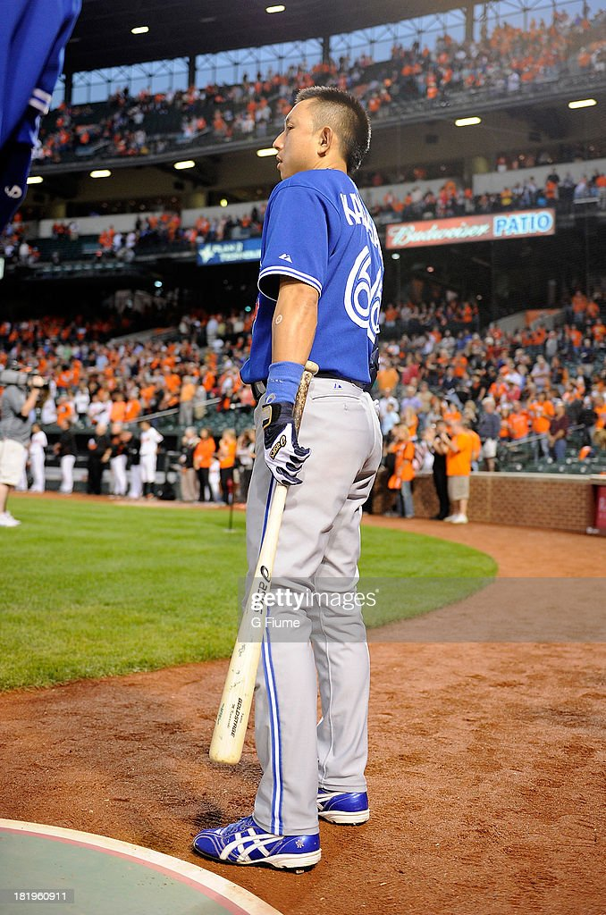 <a gi-track='captionPersonalityLinkClicked' href=/galleries/search?phrase=Munenori+Kawasaki&family=editorial&specificpeople=690355 ng-click='$event.stopPropagation()'>Munenori Kawasaki</a> #66 of the Toronto Blue Jays stands for the national anthem before the game against the Baltimore Orioles at Oriole Park at Camden Yards on September 26, 2013 in Baltimore, Maryland.