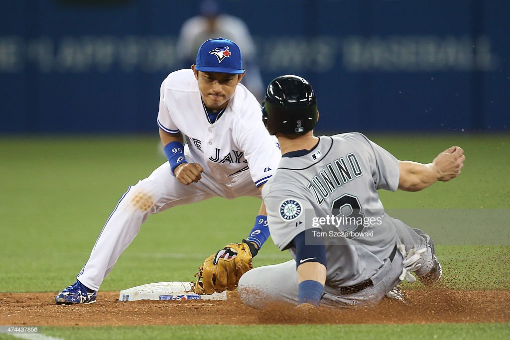 <a gi-track='captionPersonalityLinkClicked' href=/galleries/search?phrase=Munenori+Kawasaki&family=editorial&specificpeople=690355 ng-click='$event.stopPropagation()'>Munenori Kawasaki</a> #66 of the Toronto Blue Jays tags out <a gi-track='captionPersonalityLinkClicked' href=/galleries/search?phrase=Mike+Zunino&family=editorial&specificpeople=6803368 ng-click='$event.stopPropagation()'>Mike Zunino</a> #3 of the Seattle Mariners as he is caught stealing second base in the ninth inning during MLB game action on May 22, 2015 at Rogers Centre in Toronto, Ontario, Canada.
