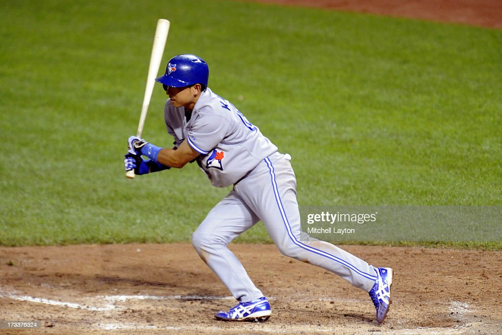 <a gi-track='captionPersonalityLinkClicked' href=/galleries/search?phrase=Munenori+Kawasaki&family=editorial&specificpeople=690355 ng-click='$event.stopPropagation()'>Munenori Kawasaki</a> #66 of the Toronto Blue Jays takes a swing during a baseball game against the Baltimore Orioles on July 12, 2013 at Oriole Park at Camden Yards in Baltimore, Maryland.