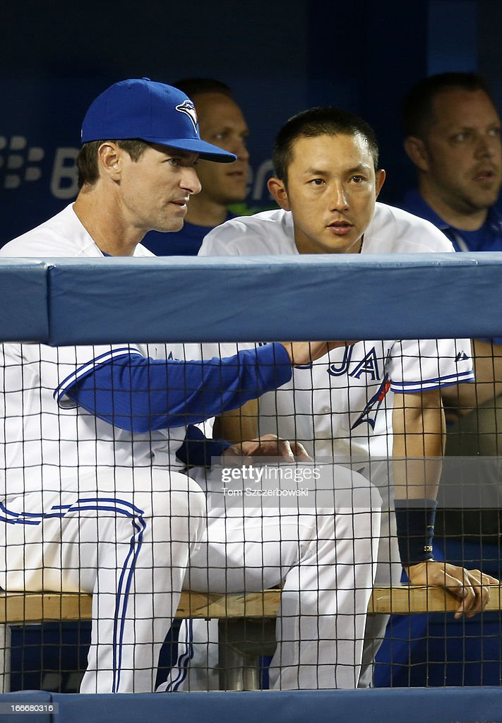 <a gi-track='captionPersonalityLinkClicked' href=/galleries/search?phrase=Munenori+Kawasaki&family=editorial&specificpeople=690355 ng-click='$event.stopPropagation()'>Munenori Kawasaki</a> (R) of the Toronto Blue Jays talks to hitting coach Chad Mottola in the dugout during MLB game action against the Chicago White Sox on April 15, 2013 at Rogers Centre in Toronto, Ontario, Canada. All uniformed team members are wearing jersey number 42 in honor of Jackie Robinson Day.