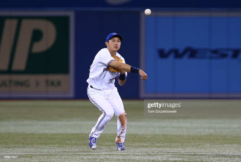 <a gi-track='captionPersonalityLinkClicked' href=/galleries/search?phrase=Munenori+Kawasaki&family=editorial&specificpeople=690355 ng-click='$event.stopPropagation()'>Munenori Kawasaki</a> of the Toronto Blue Jays throws out the baserunner to end the game during MLB game action against the Chicago White Sox on April 15, 2013 at Rogers Centre in Toronto, Ontario, Canada. All uniformed team members are wearing jersey number 42 in honor of Jackie Robinson Day.