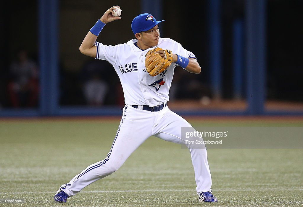 <a gi-track='captionPersonalityLinkClicked' href=/galleries/search?phrase=Munenori+Kawasaki&family=editorial&specificpeople=690355 ng-click='$event.stopPropagation()'>Munenori Kawasaki</a> #66 of the Toronto Blue Jays throws out the baserunner in the ninth inning during MLB game action against the Boston Red Sox on August 15, 2013 at Rogers Centre in Toronto, Ontario, Canada.