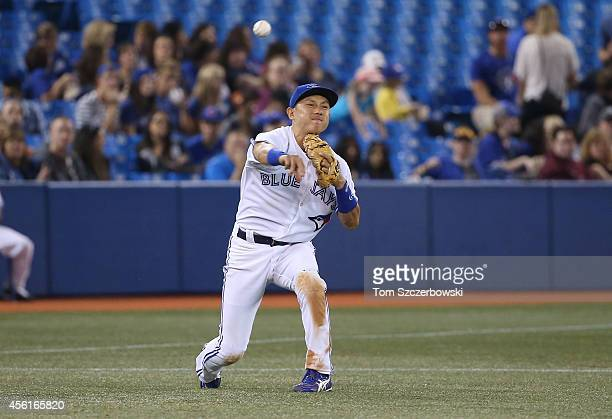Munenori Kawasaki of the Toronto Blue Jays throws out the baserunner in the fifth inning during MLB game action against the Baltimore Orioles on...
