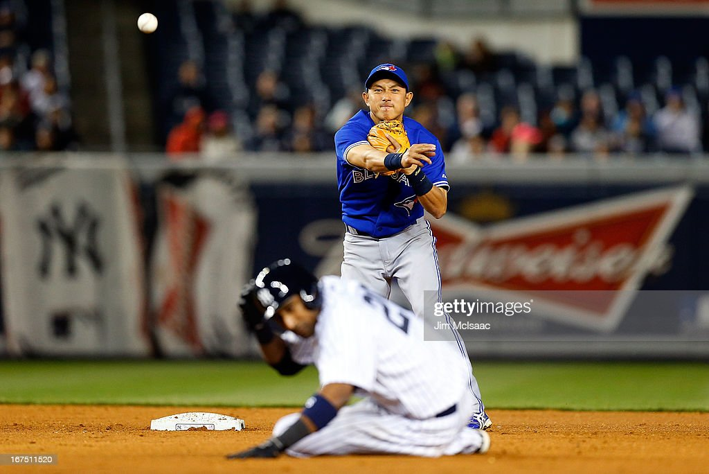 <a gi-track='captionPersonalityLinkClicked' href=/galleries/search?phrase=Munenori+Kawasaki&family=editorial&specificpeople=690355 ng-click='$event.stopPropagation()'>Munenori Kawasaki</a> #66 of the Toronto Blue Jays throws to first base to complete an eighth inning ending double play after forcing out <a gi-track='captionPersonalityLinkClicked' href=/galleries/search?phrase=Eduardo+Nunez&family=editorial&specificpeople=4900197 ng-click='$event.stopPropagation()'>Eduardo Nunez</a> #26 of the New York Yankees at Yankee Stadium on April 25, 2013 in the Bronx borough of New York City.