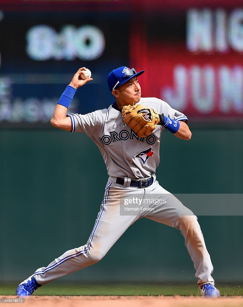 <a gi-track='captionPersonalityLinkClicked' href=/galleries/search?phrase=Munenori+Kawasaki&family=editorial&specificpeople=690355 ng-click='$event.stopPropagation()'>Munenori Kawasaki</a> #66 of the Toronto Blue Jays throws to get out Eduardo Nunez #9 of the Minnesota Twins at first base during the eighth inning of the game on May 31, 2015 at Target Field in Minneapolis, Minnesota. The Twins defeated the Blues Jays 6-5.