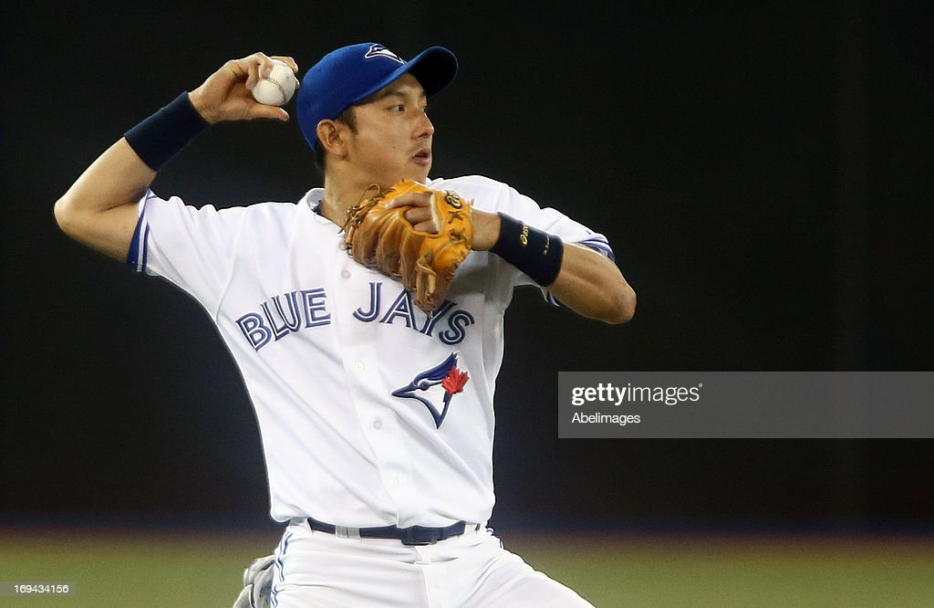 Munenori Kawasaki #66 of the Toronto Blue Jays throws to second base against the Baltimore Orioles during MLB action at the Rogers Centre May 24, 2013 in Toronto, Ontario, Canada.