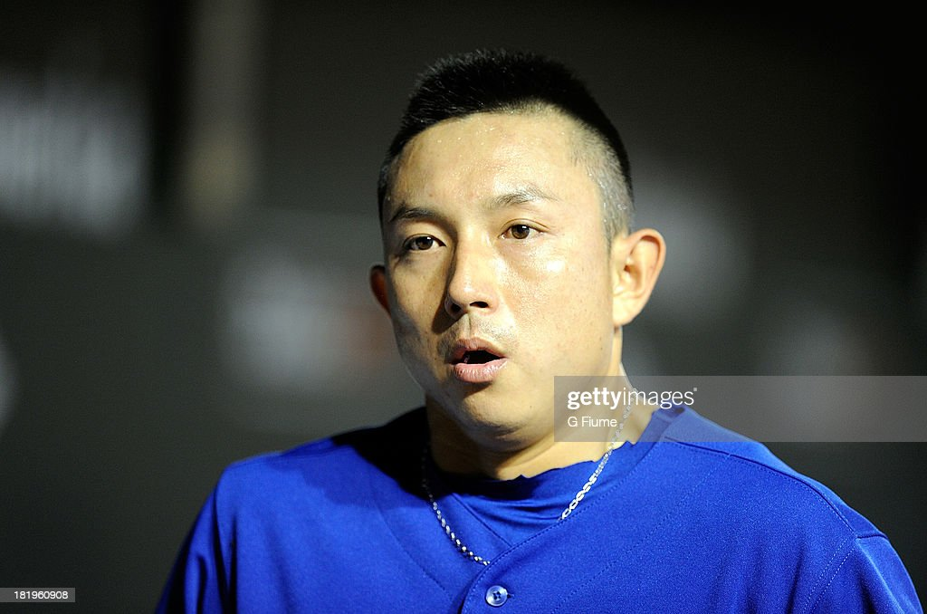 <a gi-track='captionPersonalityLinkClicked' href=/galleries/search?phrase=Munenori+Kawasaki&family=editorial&specificpeople=690355 ng-click='$event.stopPropagation()'>Munenori Kawasaki</a> #66 of the Toronto Blue Jays walks in the dugout after scoring in the first inning against the Baltimore Orioles at Oriole Park at Camden Yards on September 26, 2013 in Baltimore, Maryland.