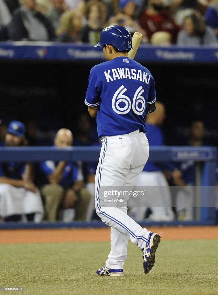 <a gi-track='captionPersonalityLinkClicked' href=/galleries/search?phrase=Munenori+Kawasaki&family=editorial&specificpeople=690355 ng-click='$event.stopPropagation()'>Munenori Kawasaki</a> #66 of the Toronto Blue Jays walks off the field after striking out in the eighth inning during MLB game action against the Baltimore Orioles September 15, 2013 at Rogers Centre in Toronto, Ontario, Canada.