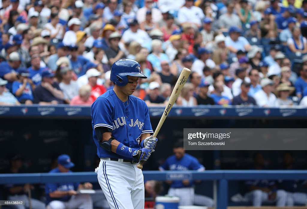 <a gi-track='captionPersonalityLinkClicked' href=/galleries/search?phrase=Munenori+Kawasaki&family=editorial&specificpeople=690355 ng-click='$event.stopPropagation()'>Munenori Kawasaki</a> #66 of the Toronto Blue Jays walks to home plate for his at bat in the third inning during MLB game action against the New York Yankees on August 31, 2014 at Rogers Centre in Toronto, Ontario, Canada.