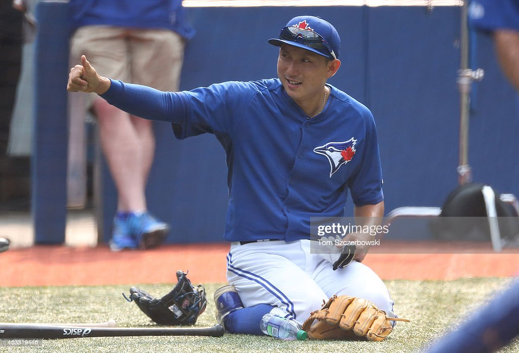 Munenori Kawasaki #66 of the Toronto Blue Jays warms up before the start of MLB game action against the Baltimore Orioles on August 7, 2014 at Rogers Centre in Toronto, Ontario, Canada.