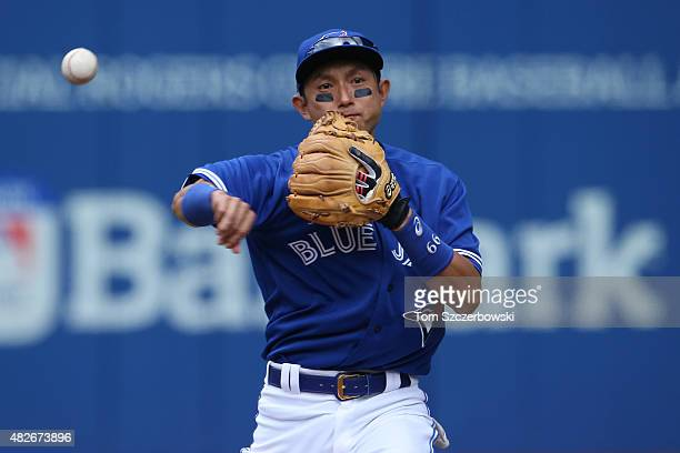 Munenori Kawasaki of the Toronto Blue Jays warms up before the start of the inning during MLB game action against the Kansas City Royals on August 1...