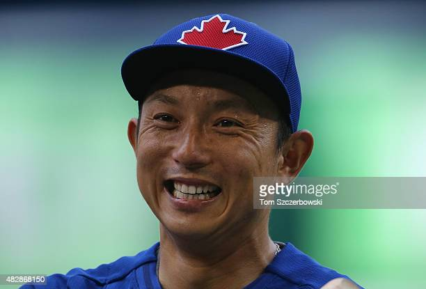 Munenori Kawasaki of the Toronto Blue Jays warms up before the start of their MLB game against the Minnesota Twins on August 3 2015 at Rogers Centre...