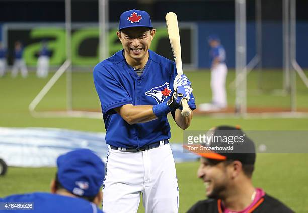 Munenori Kawasaki of the Toronto Blue Jays warms up during batting practice before the start of MLB game action against the Miami Marlins on June 9...
